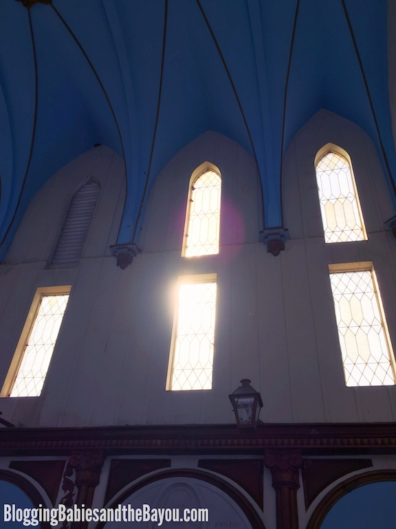 Light shining through the chapel windows at Saint Roch Cemetery in New Orleans #BayouTravel