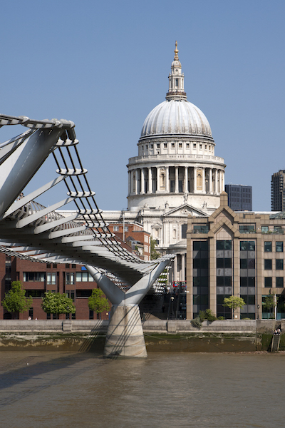 Did You Know? Travel Series – St Paul Cathedral London UK #BayouTravel St Paul's Cathedral, view from Milenium bridge - Double decker passing  St. Paul Cathedral  in London